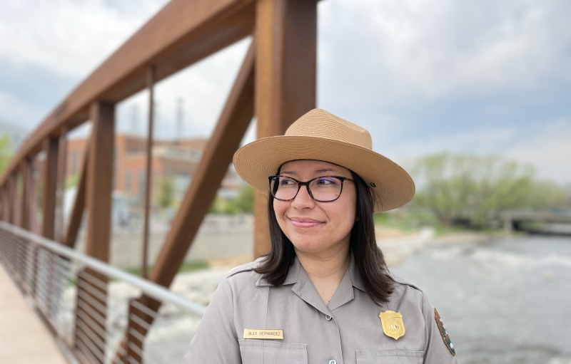 Alex Hernandez stands on a bridge, in ranger uniform, looking into the distance