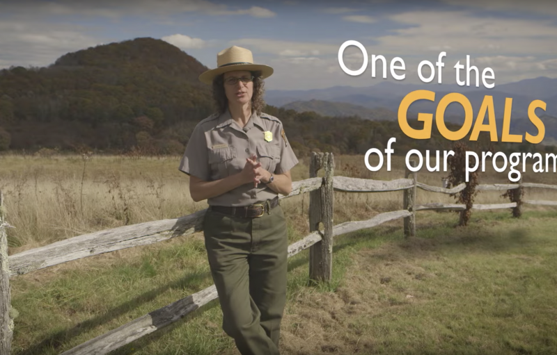 "Park ranger talking outside with ""one of the goals of our program"" as overlay text"