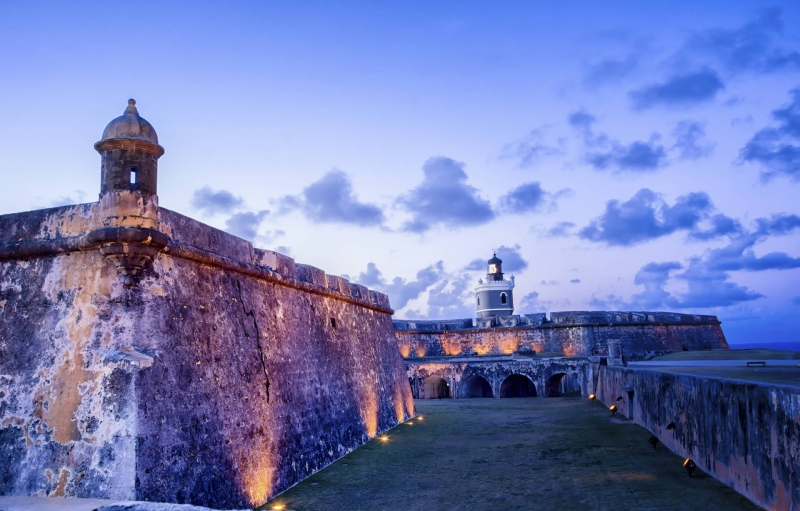 twilight at San Juan, lights shine up on fort walls
