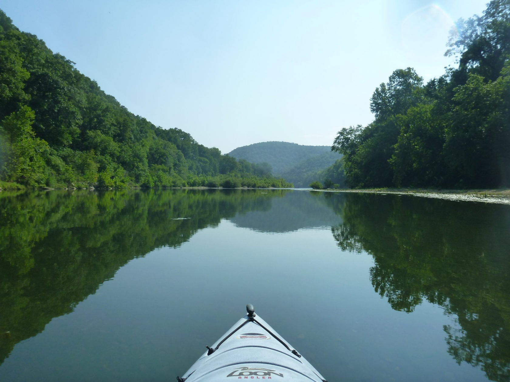 View from a kayak paddling down Buffalo National River in Arkansas