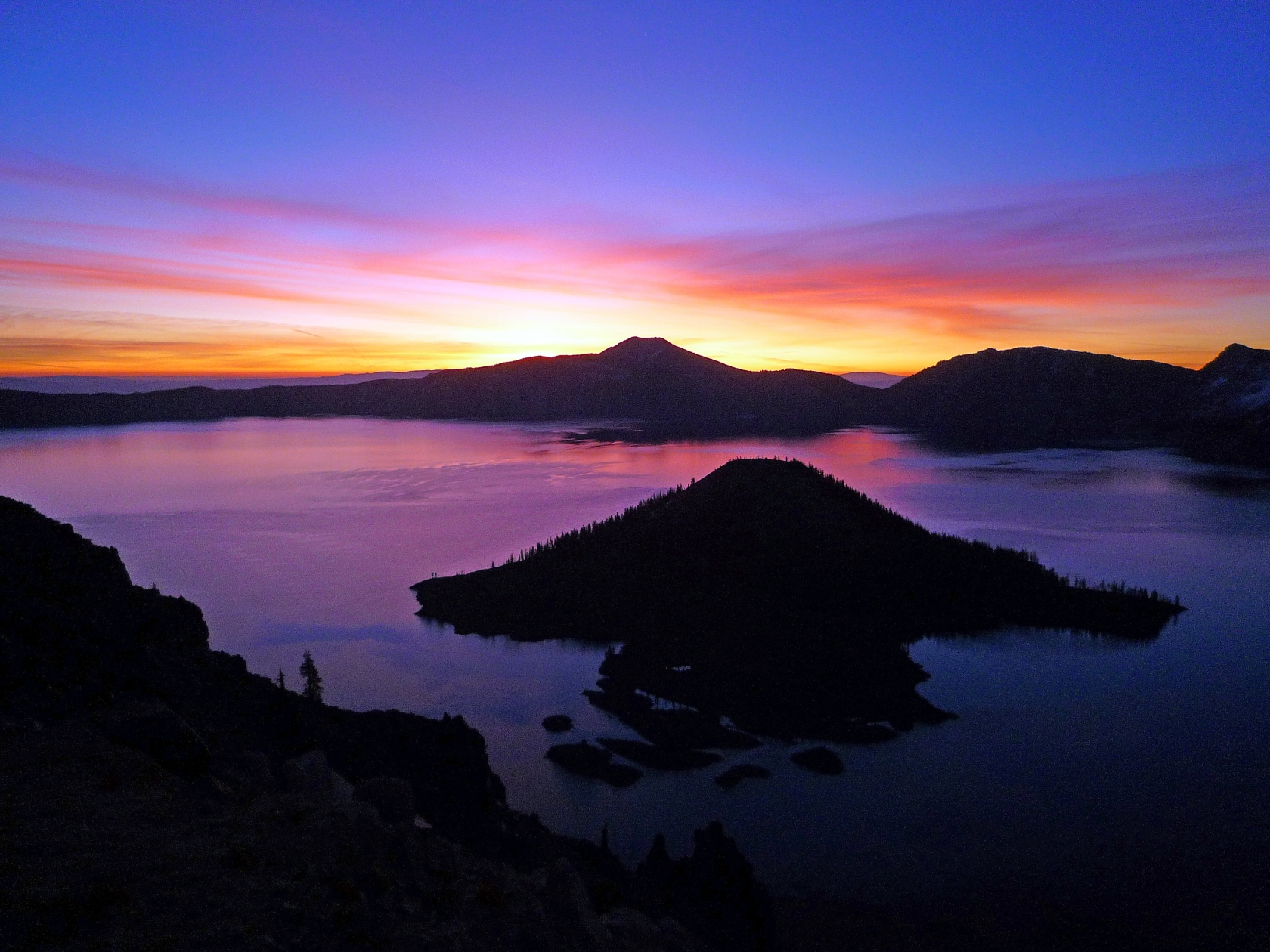 Rainbow-colored sunrise over Crater Lake National Park