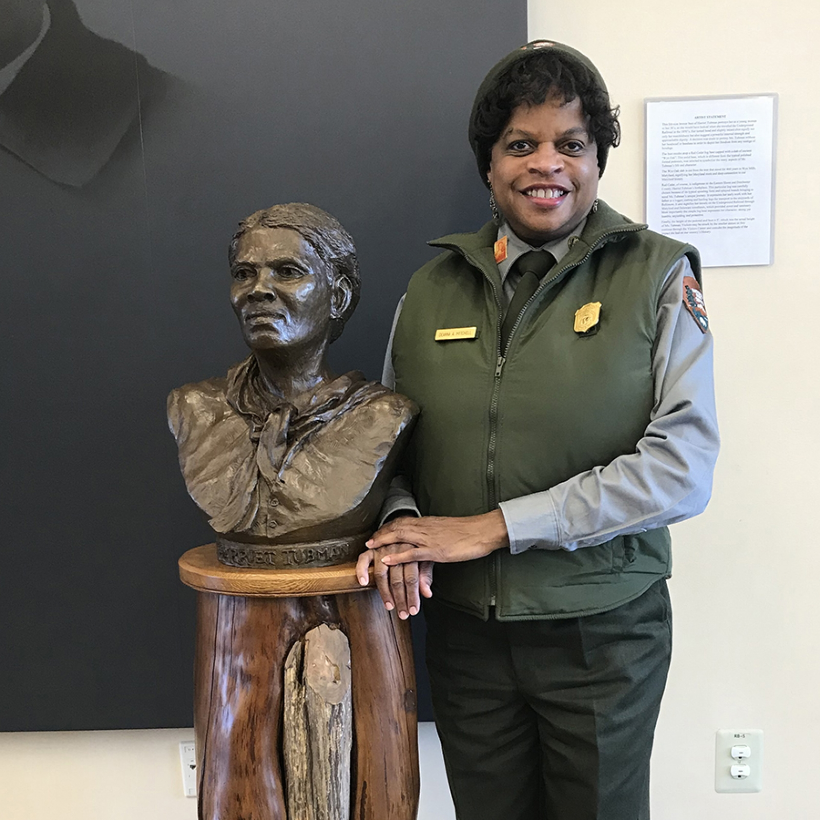 Deanna Mitchell stands next to a bust of Harriet Tubman inside the park's visitor center
