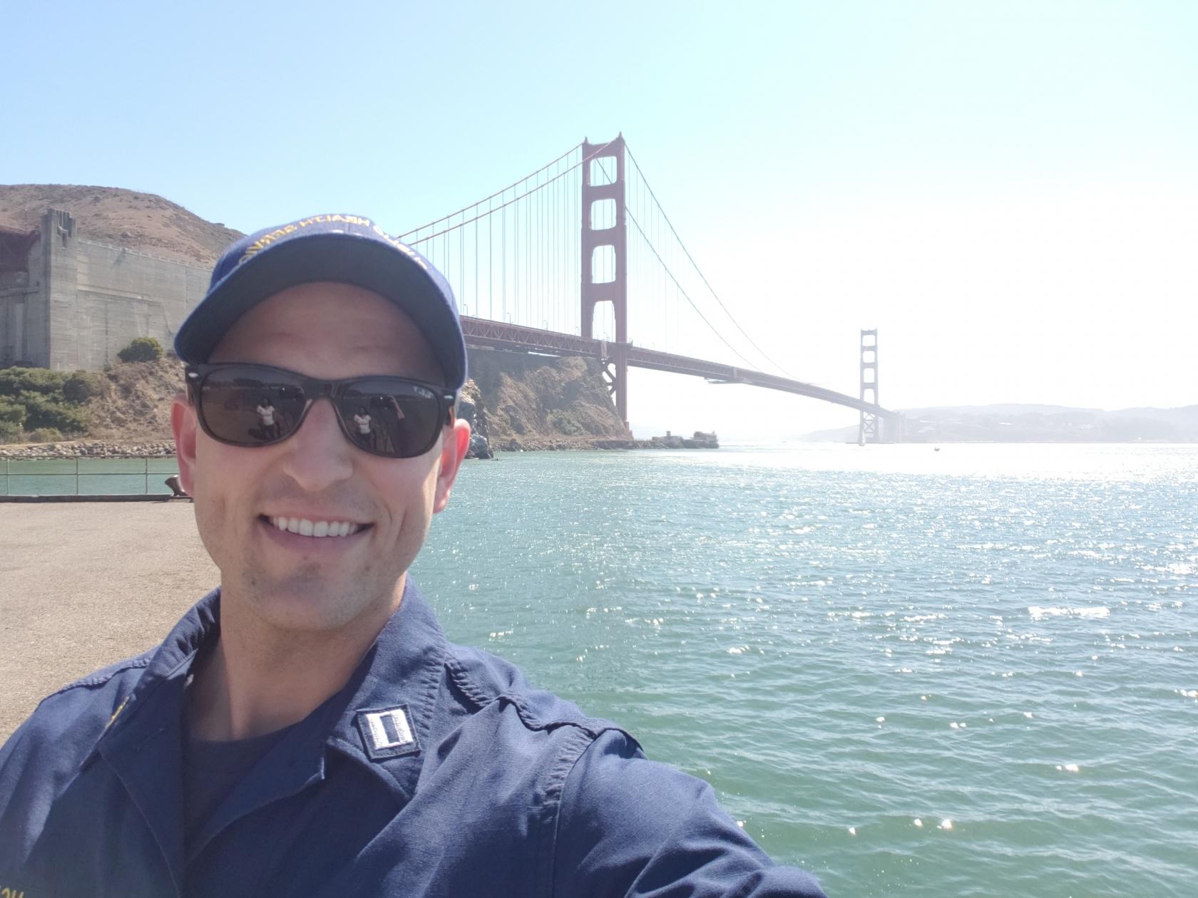 Selfie of LCDR Matt Kozler in front of the Golden Gate Bridge in San Francisco, California