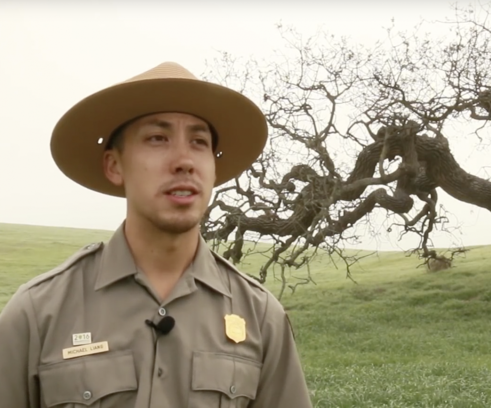 National Park Ranger Michael Liang talking with a tree in the background at Santa Monica National Recreation Area