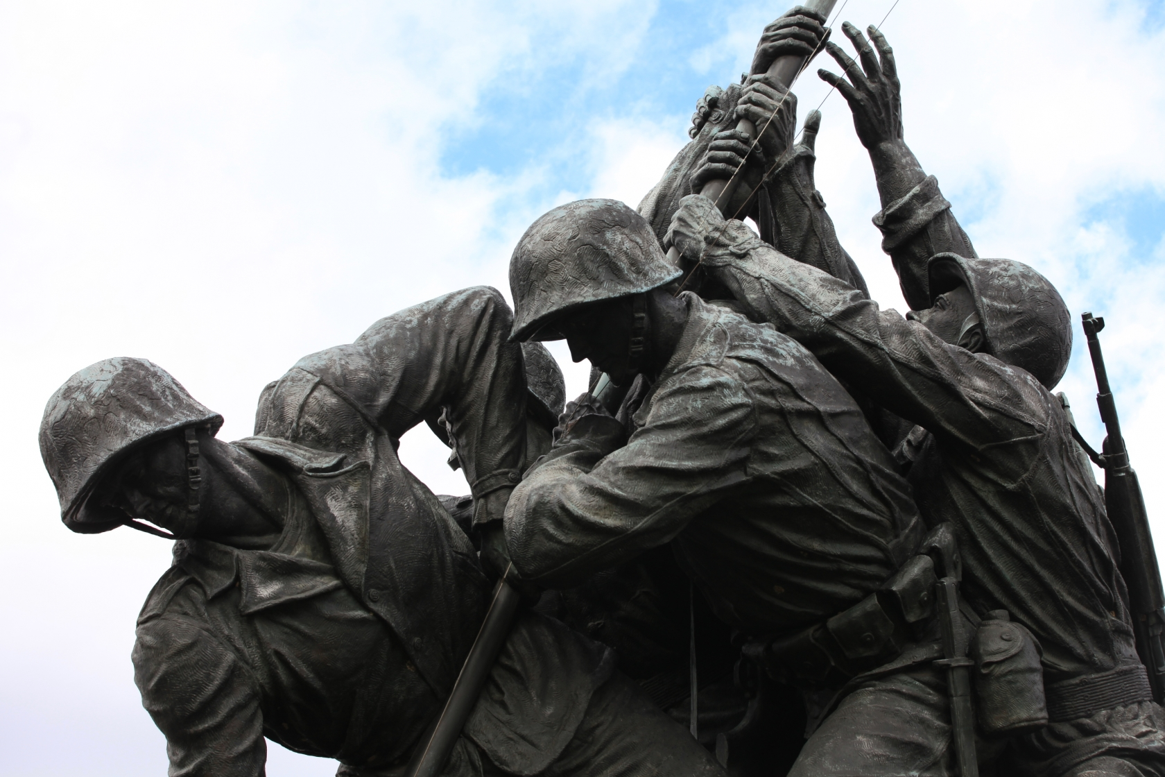The soldiers lift the flag pole in the U.S. Marine Corps War Memorial