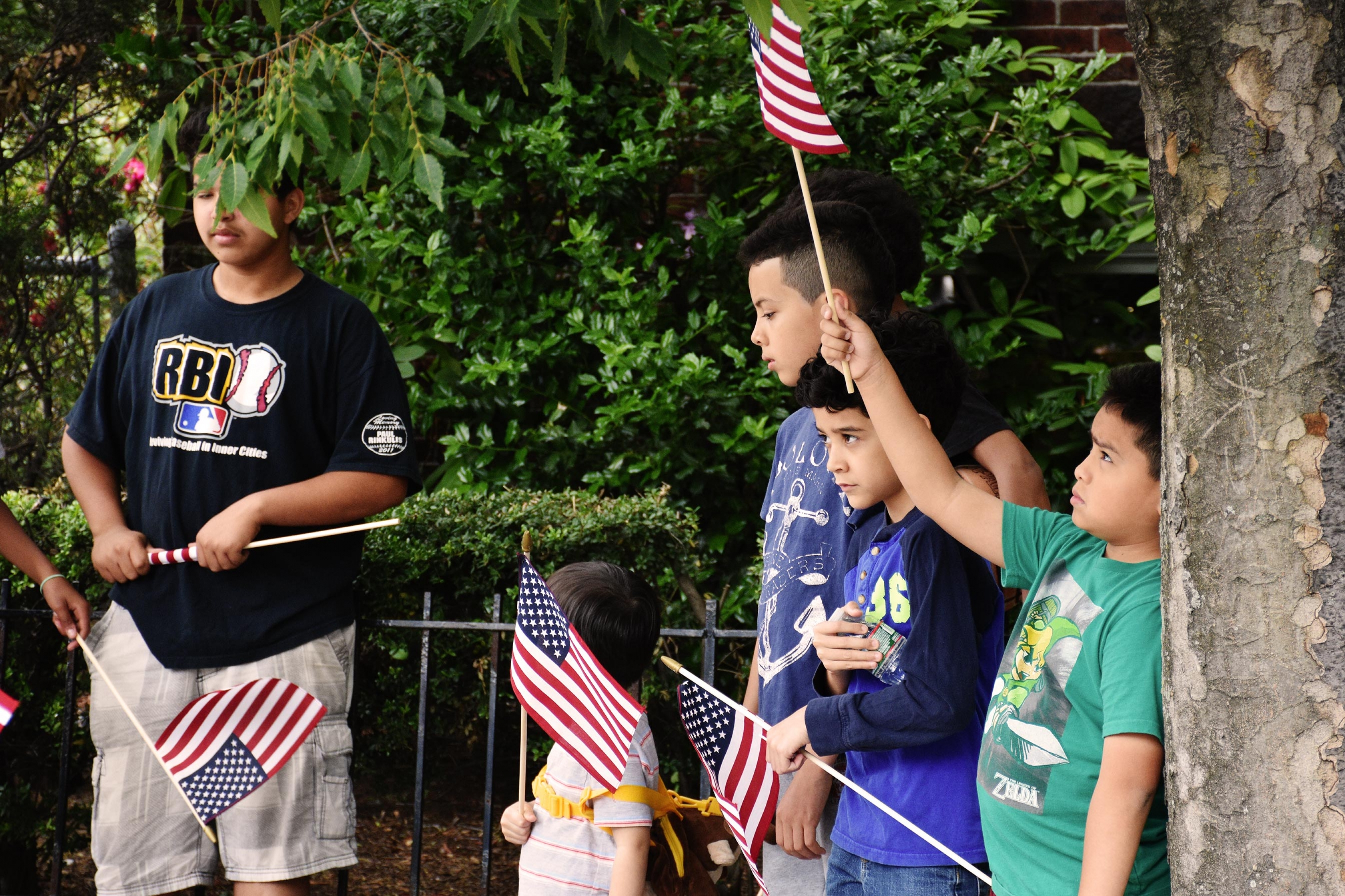 Kids waving flags at the Bunker Hill Parade in Boston.