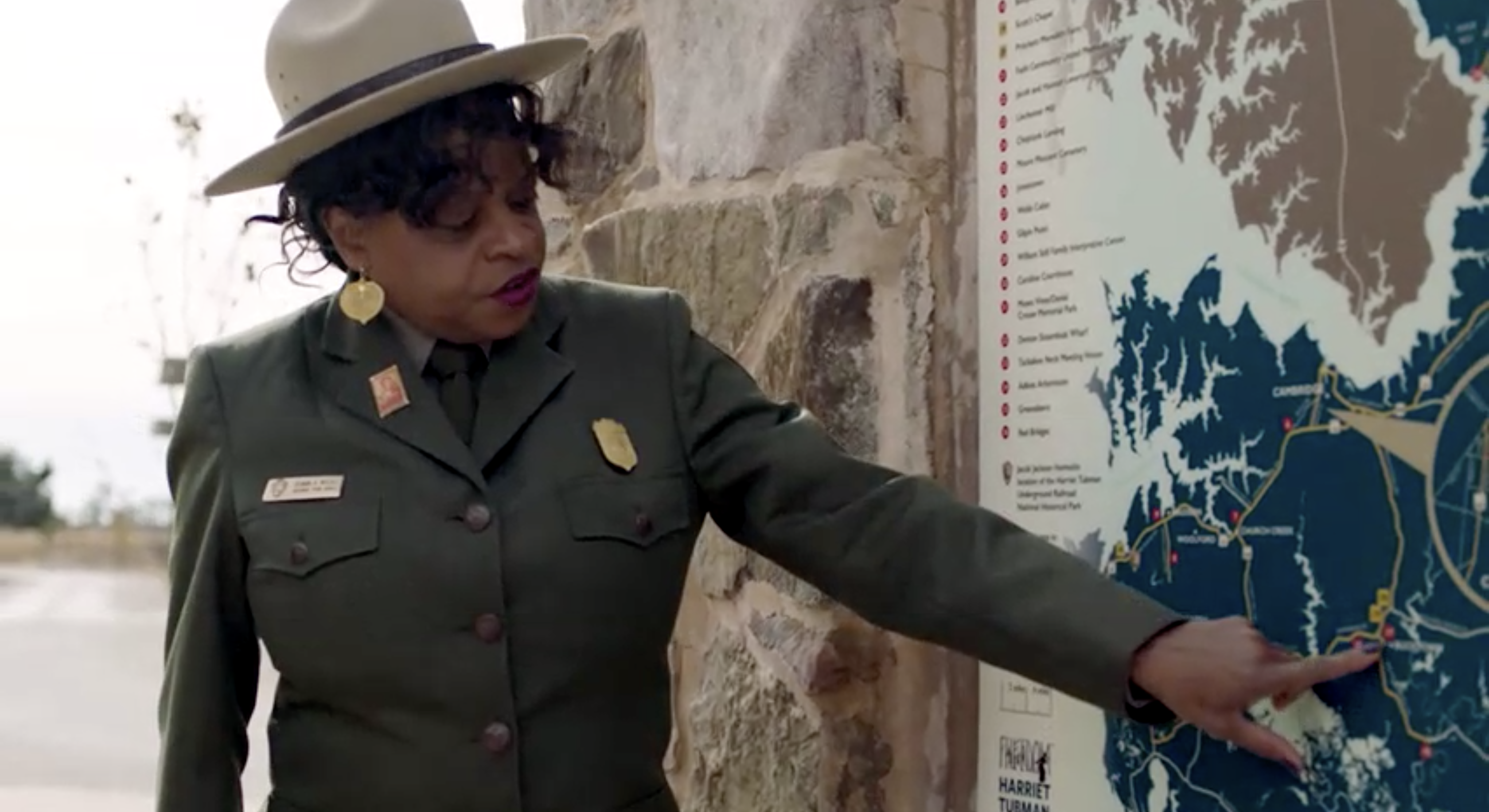 A National Park Service Employee points to a spot on a map