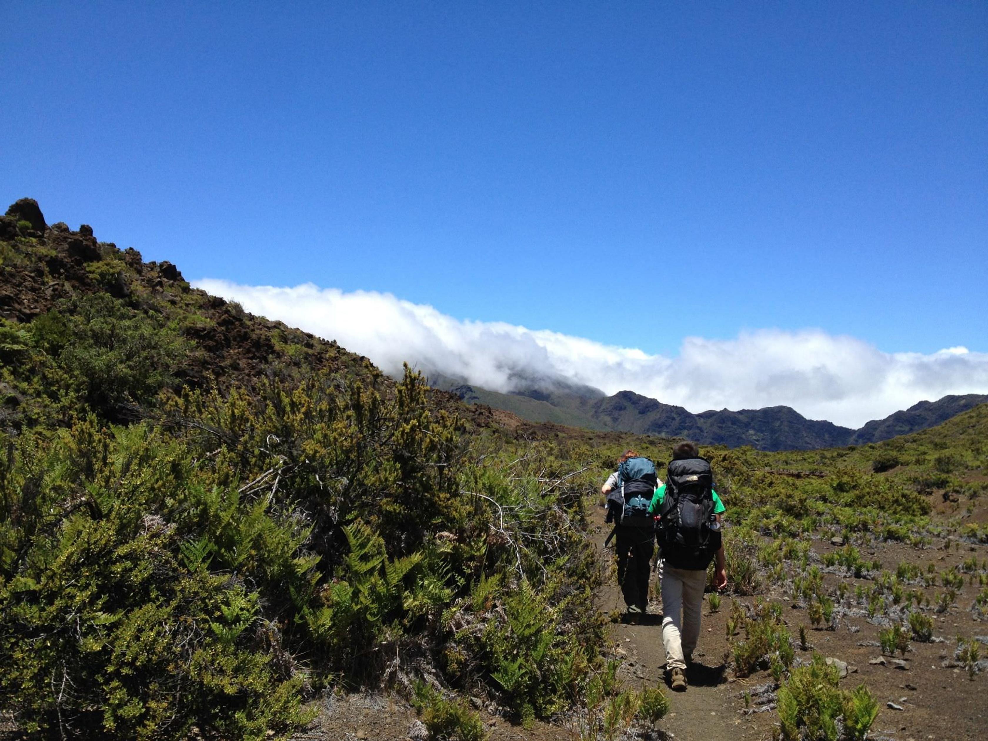 Backpackers head through Haleakala National Park.