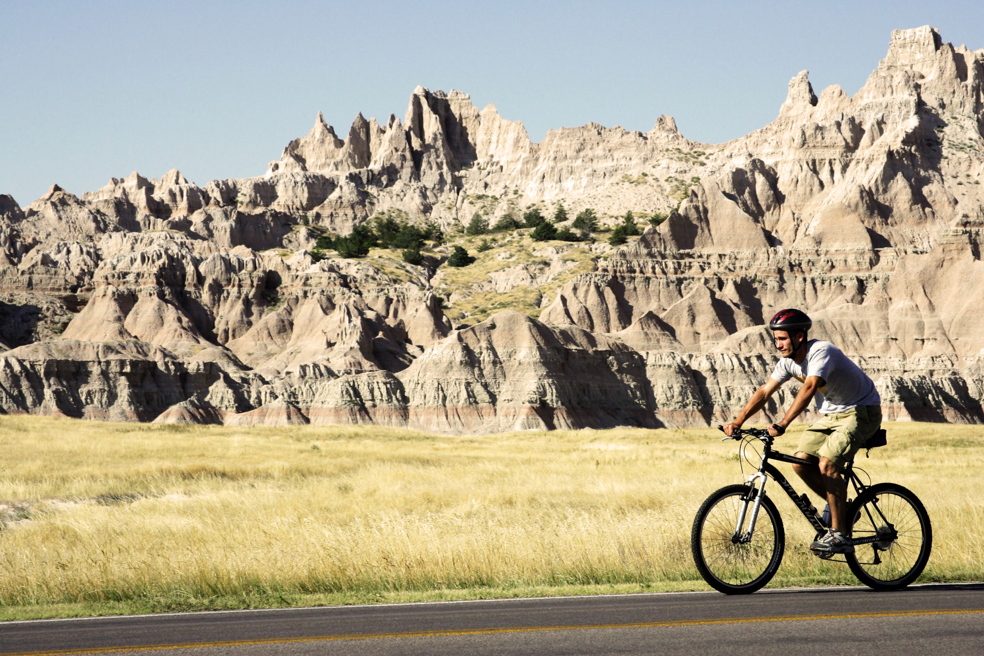 A man bikes through Badlands National Park.