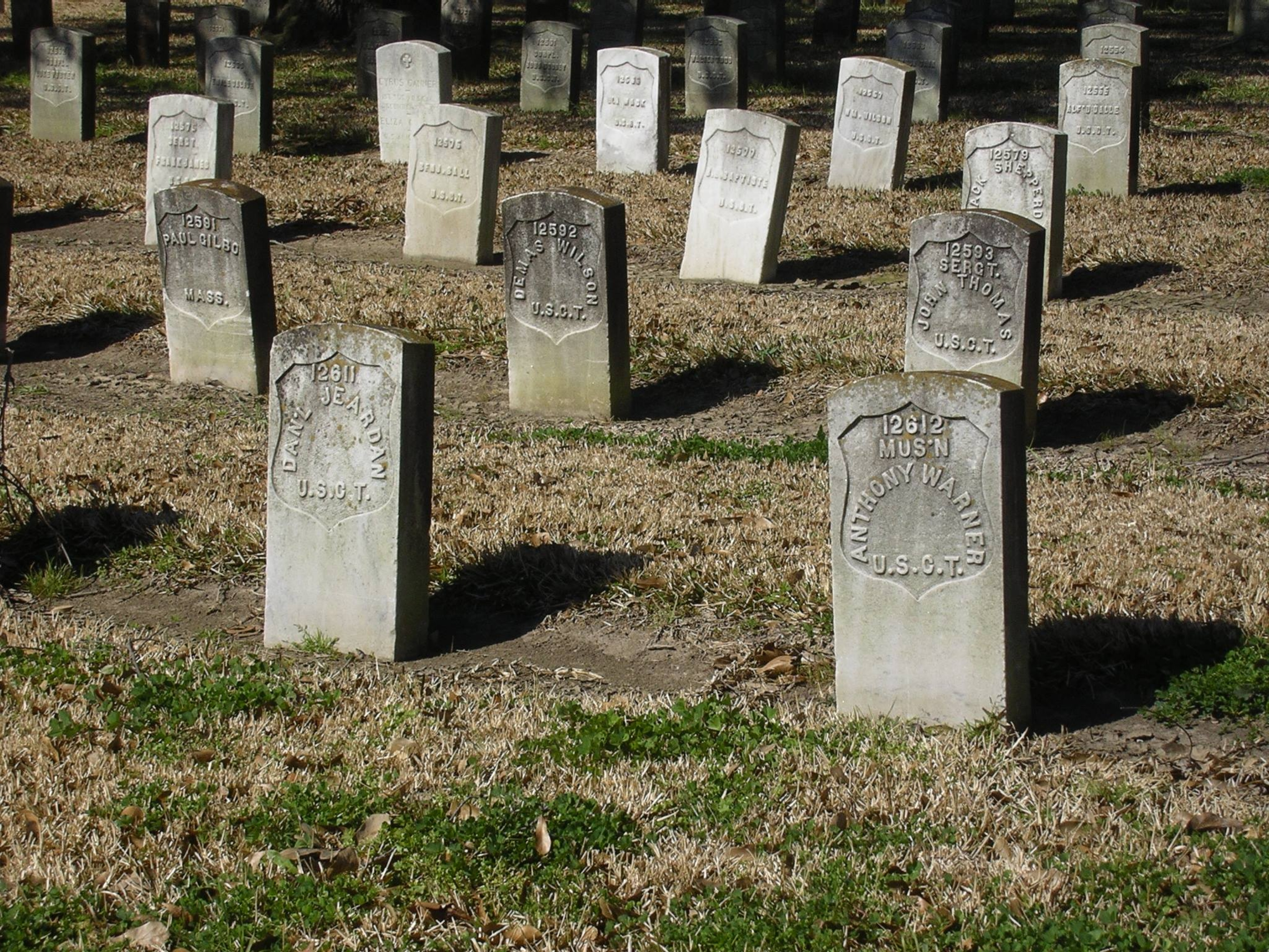 Headstones in the sunlight at the Chalmette National Cemetery at Jean Lafitte National Historic Park and Preserve