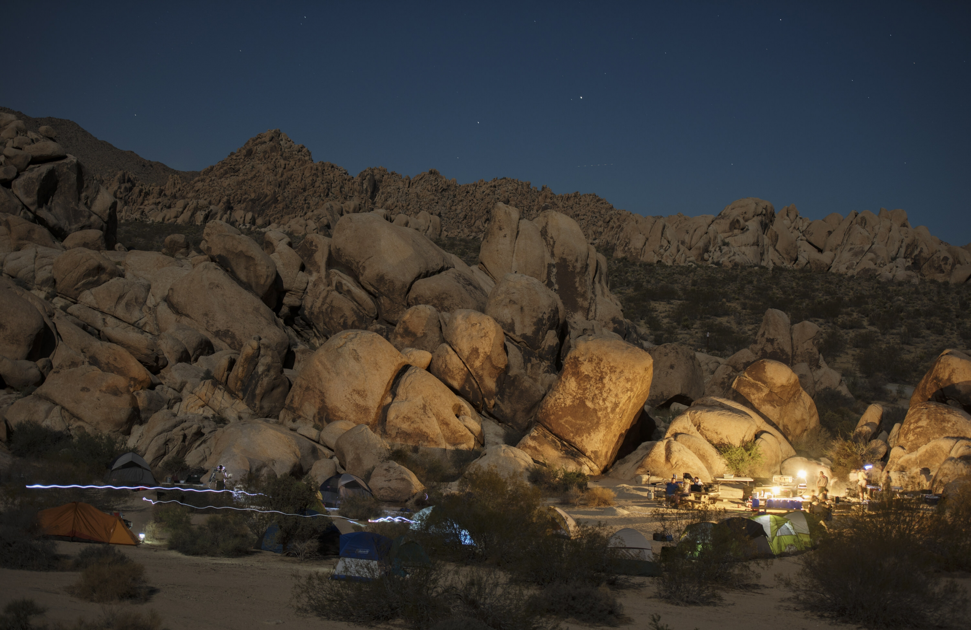 Illuminated campground under a starry night at Joshua Tree National Park