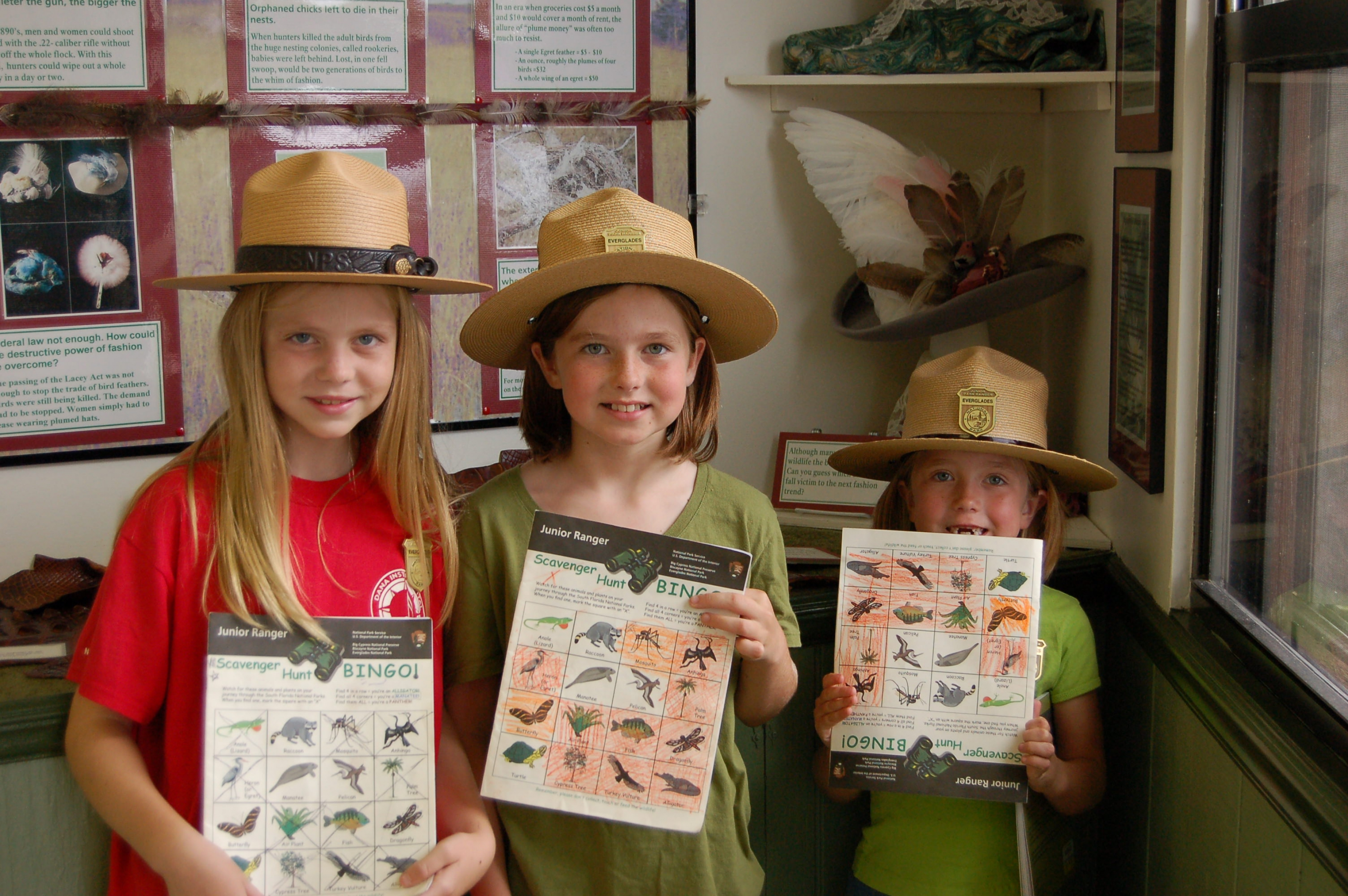 Three kids enjoy becoming junior rangers at Everglades National Park.