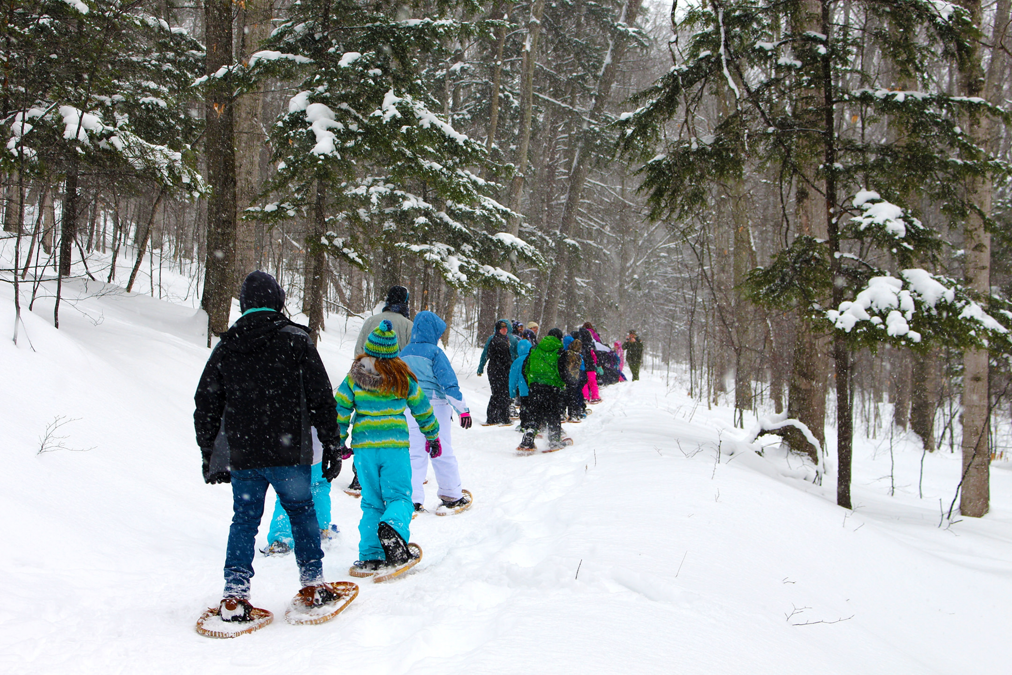 Kids snowshoe through Sleeping Bear Dunes National Park.