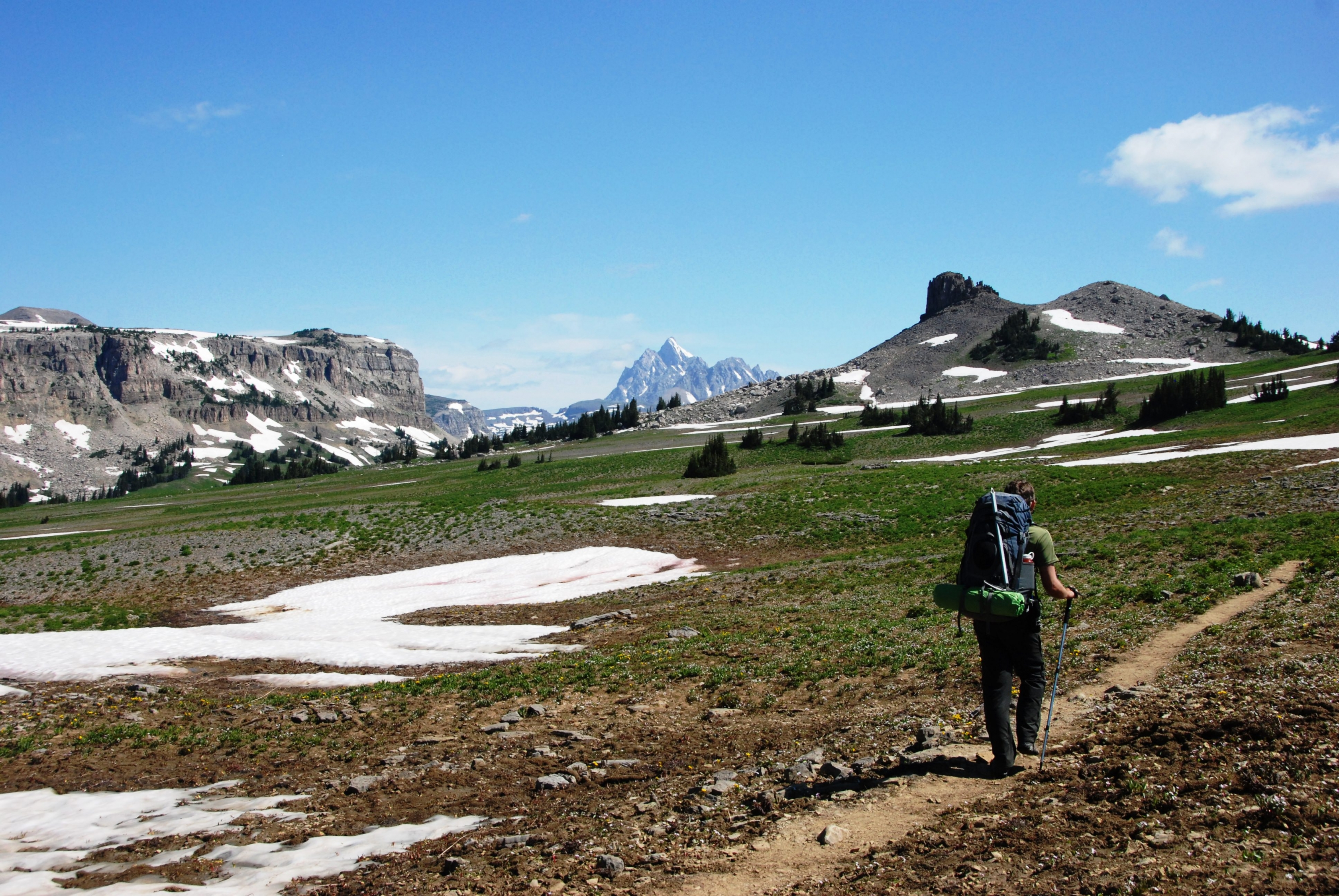 A solo hiker along a crest trail in Grand Teton National Park.