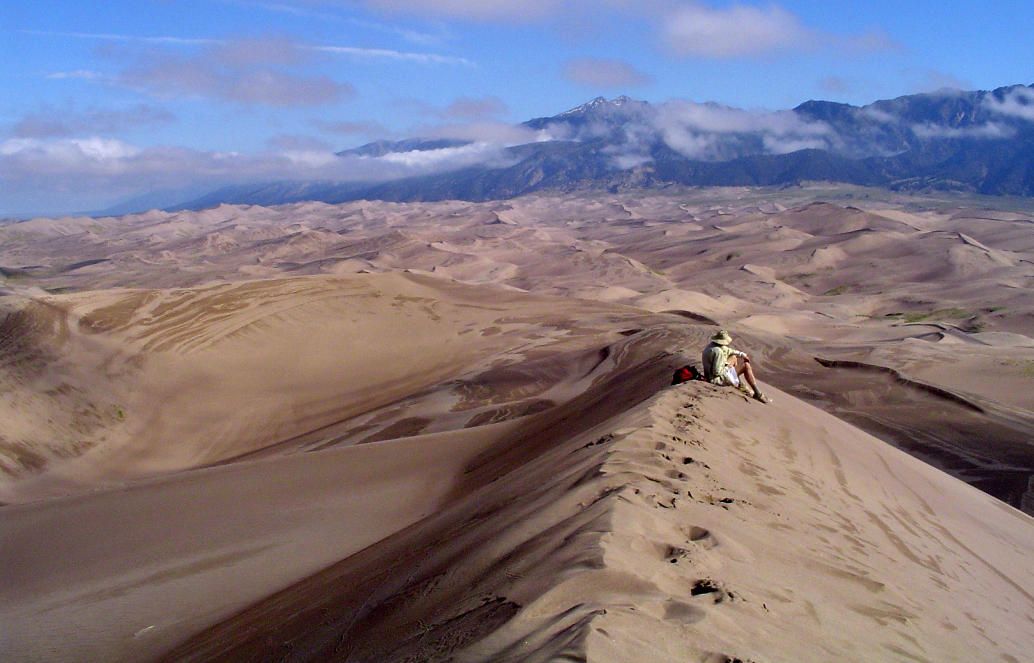 A solo hiker in Great Sand Dunes National Park in Colorado.