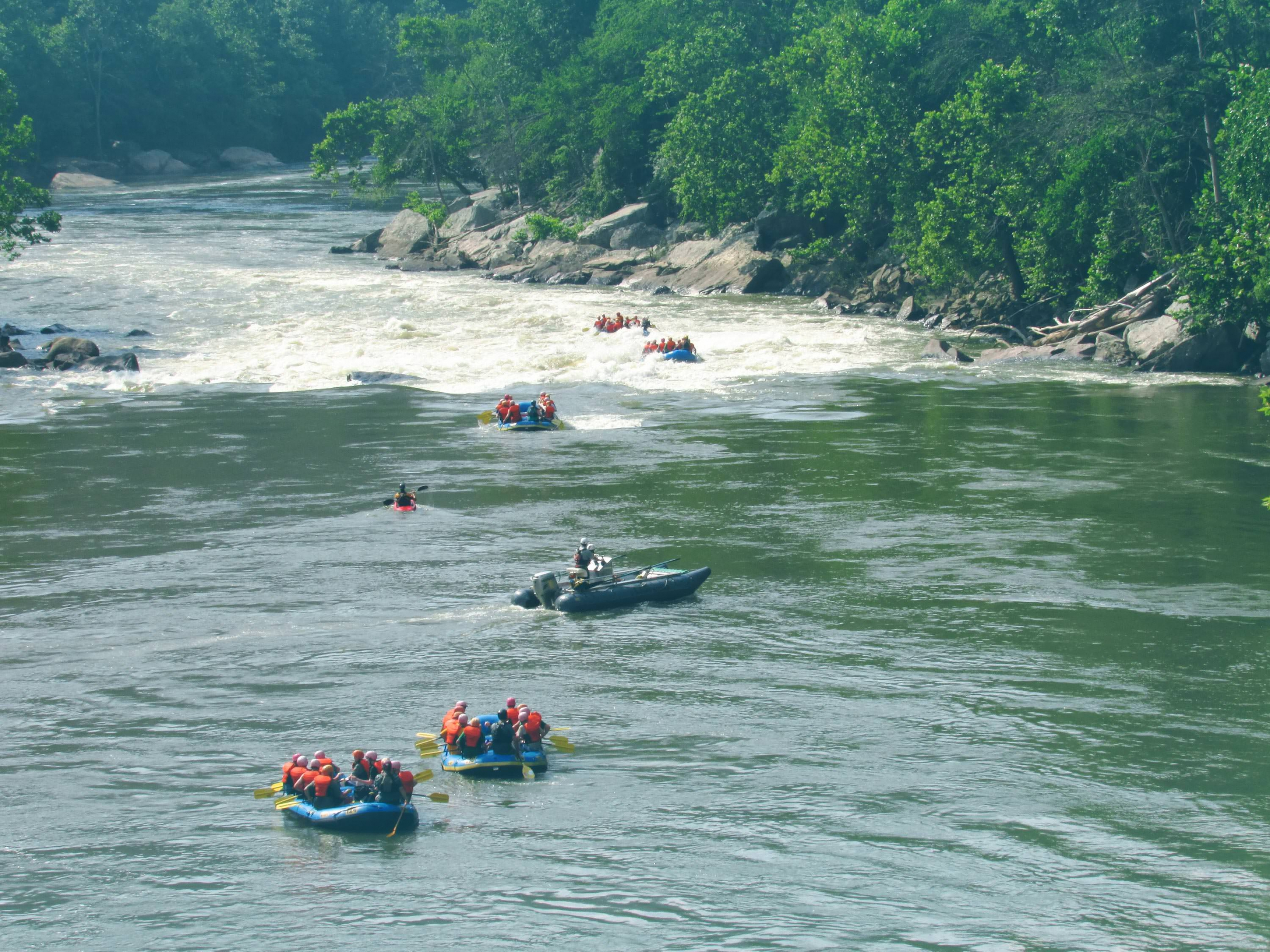 A group of rafters braves the New River Gorge.