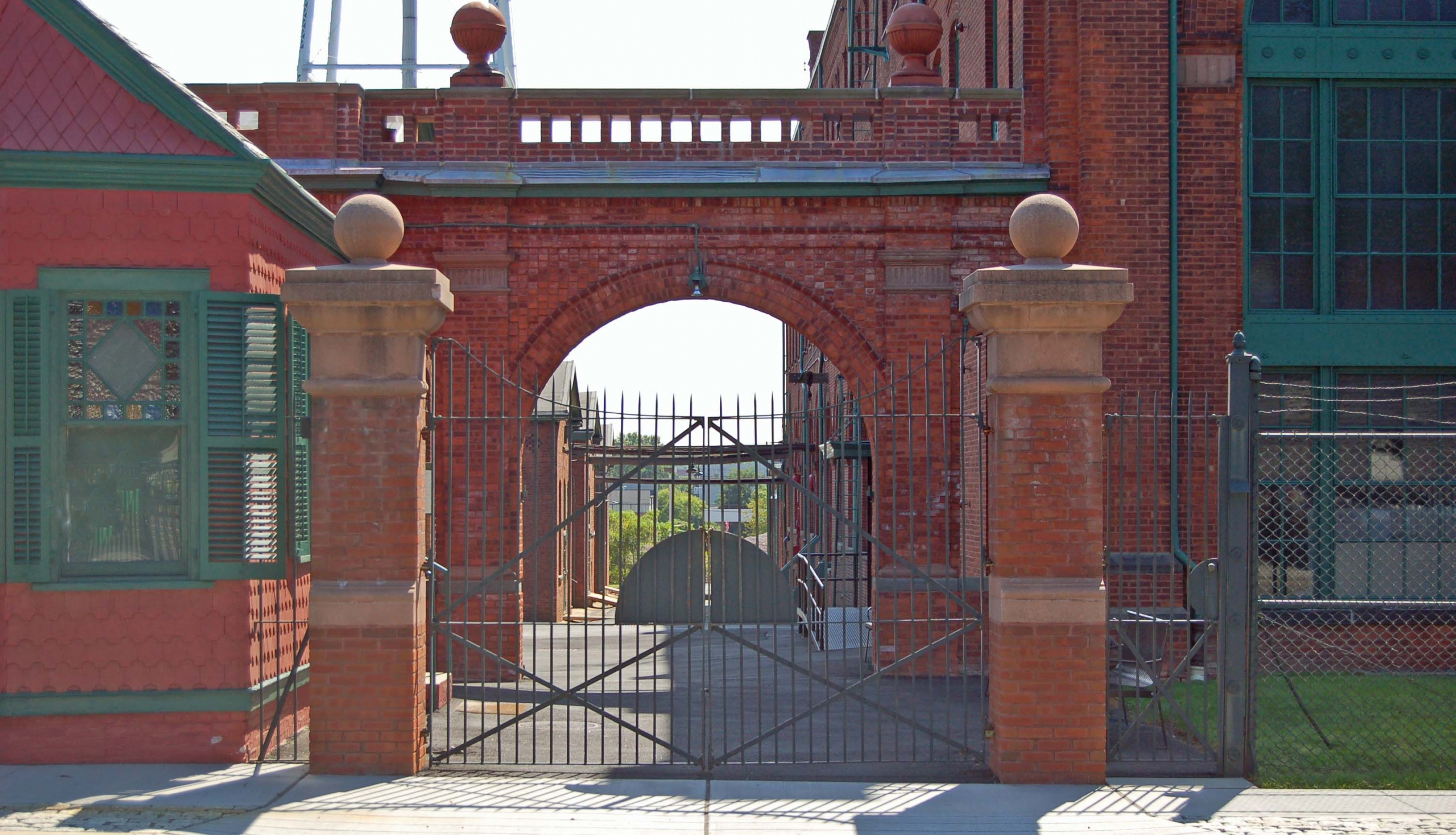 Metal gate entrance fo a red brick and green-windowed building at the Thomas Edison National Historical Park