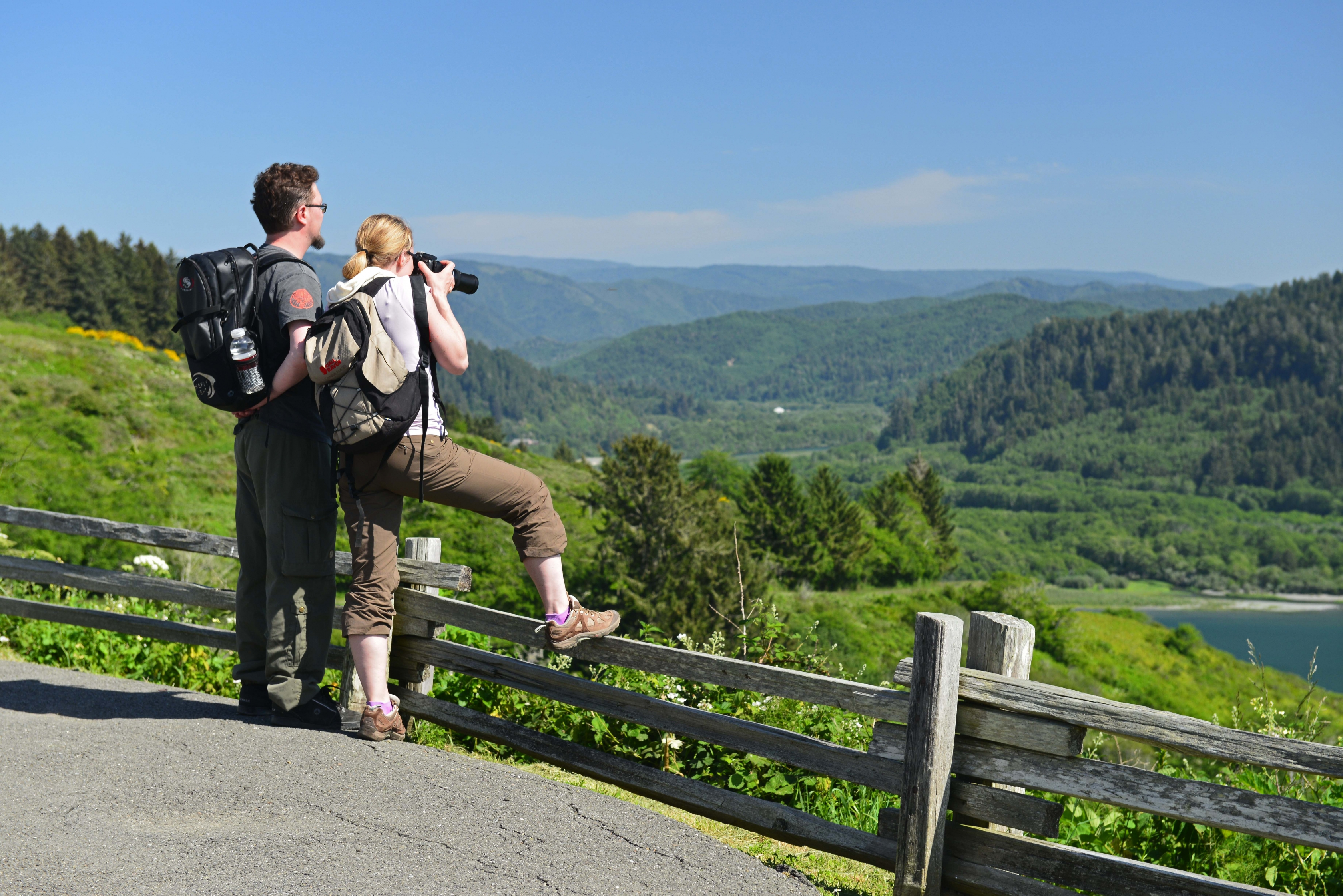 Visitors take in the scenery at Klamath River Overlook in the Redwoods.