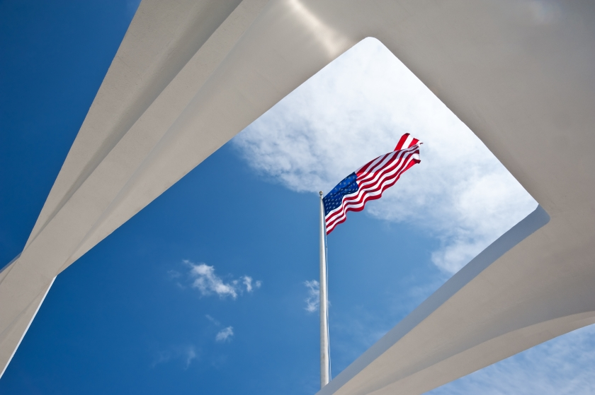 American flag waving in the wind, as seen from below on the USS Arizona Memorial